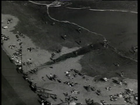 1933 aerial scene from the film convention city with beach activities at atlantic city and buildings along the beach / atlantic city, new jersey, united states - new jersey stock videos & royalty-free footage