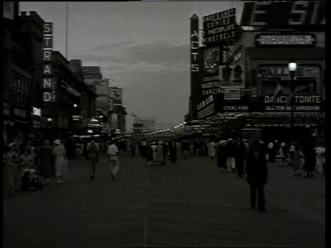 1933 ws scene from the film convention city with busy atlantic city street with people walking, buildings, and billboards in background / atlantic city, new jersey, united states - 1933 stock videos & royalty-free footage