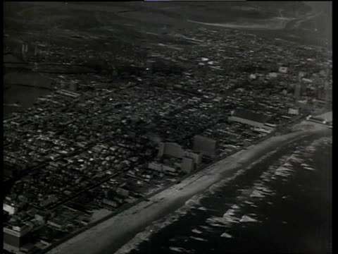 stockvideo's en b-roll-footage met 1933 aerial scene from the film convention city with shoreline and cityscape of atlantic city / new jersey, united states - 1933