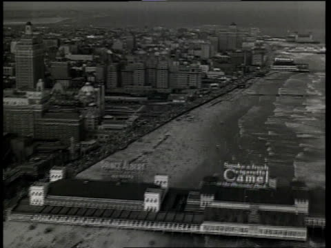 1933 aerial scene from the film convention city with shoreline of atlantic city, passing several buildings and piers while the waves roll onto the beaches / new jersey, united states - 1933 stock videos & royalty-free footage