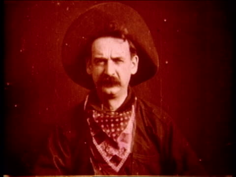 scene from 'the great train robbery' / bandit points gun and fires at camera cowboy bandit fires gun at camera on december 01 1903 in essex county... - 1903 stock-videos und b-roll-filmmaterial