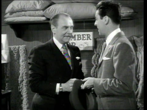 vídeos de stock e filmes b-roll de 1947 montage scene from the short movie so you want to hold your wife where george o'hanlon, playing joe visiting a sleep store talks to a salesman about ways to keep his wife from snoring - 1947