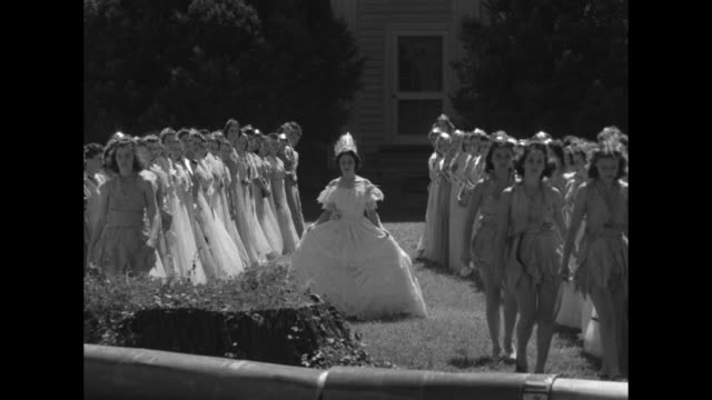scene in front of plantation mansion with giant corncob pipe standing in front of rows of festival beauties wearing gowns and sashes reading miss... - plus key stock videos & royalty-free footage