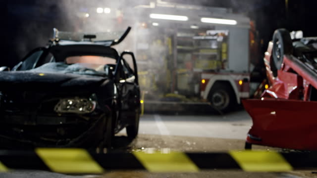 ds scene of a car accident at night secured with a barricade tape - incidente automobilistico video stock e b–roll