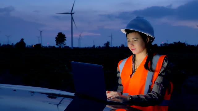 scene of engineer asian woman using the laptop at evening t to evaluate a wind turbine, concept of renewable energy plants - only mid adult women stock videos & royalty-free footage