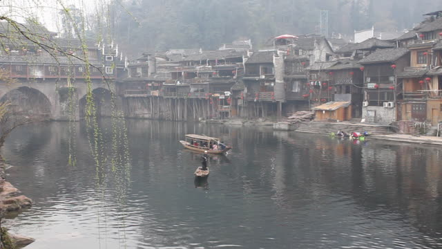 Scene of foggy southern Yangtze river town early spring morning