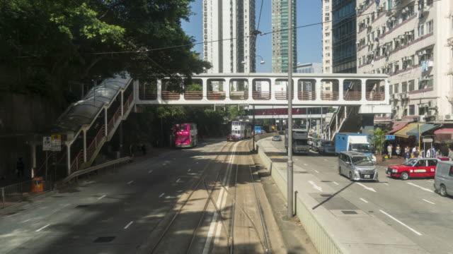 vidéos et rushes de scène de hong kong de laps de temps de téléphérique (tram) - île de hong kong