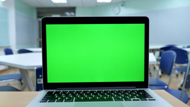 scene of laptop computer showing green chroma key screen stands in the classroom. technology in the background , concept of technology background - classroom stock videos & royalty-free footage