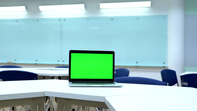 scene of laptop computer showing green chroma key screen stands in the classroom. technology in the background , concept of technology background - blank computer monitor stock videos & royalty-free footage