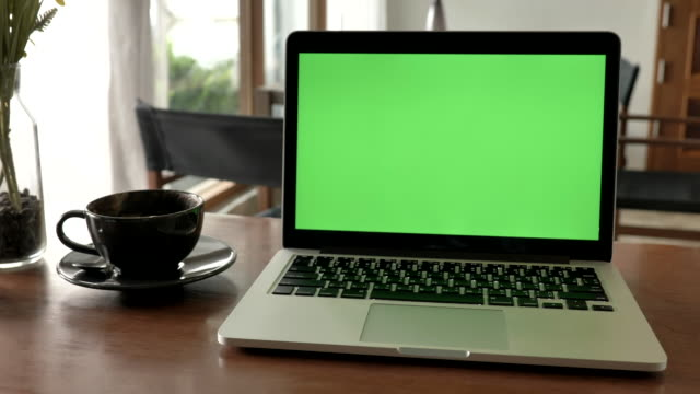 scene of laptop computer showing green chroma key screen stands on a desk at home. technology in the background , concept of technology background and day in the life objects - tabellone video stock e b–roll