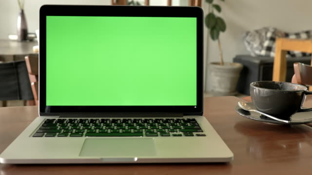 scene of laptop computer showing green chroma key screen stands on a desk at home. technology in the background , concept of technology background and day in the life objects - it professional stock videos & royalty-free footage