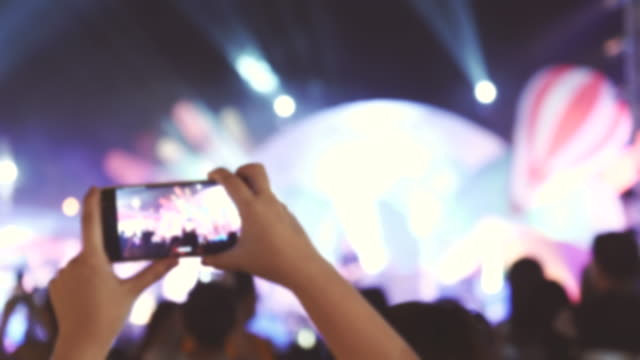 scene of music fans recording concert with mobile phones, concept of holiday end of week, lifestyle of people - fame stock videos & royalty-free footage