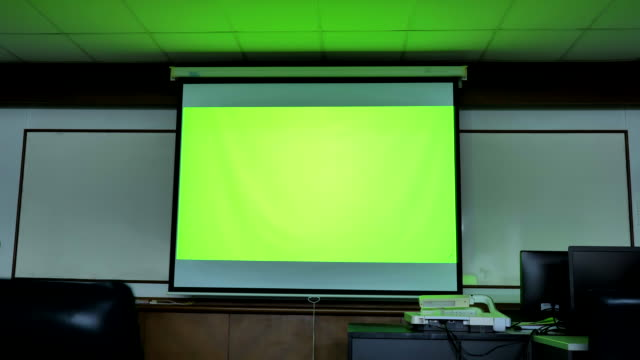 scene of projector screen showing green chroma key screen stands in the computer classroom. technology in the background , concept of technology background - whiteboard stock videos & royalty-free footage