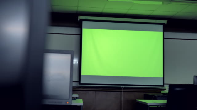 scene of projector screen showing green chroma key screen stands in the computer classroom. technology in the background , concept of technology background - projection equipment stock videos & royalty-free footage