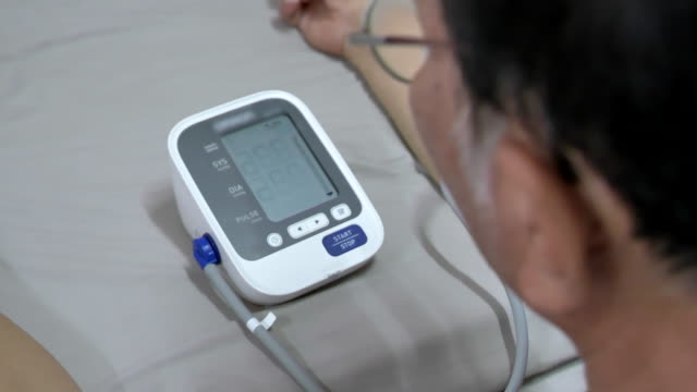 scene of senior asian male measures his pressure at home - hypertension stock videos and b-roll footage