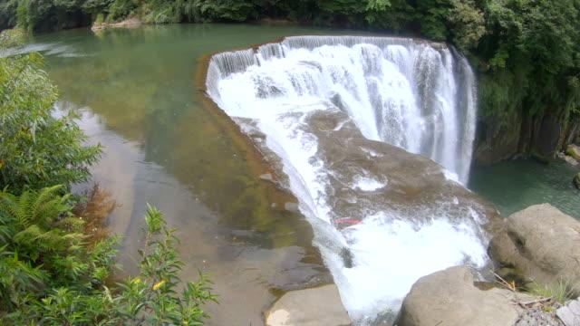 scene of shifen waterfall taipei at taiwan - taiwan stock videos & royalty-free footage