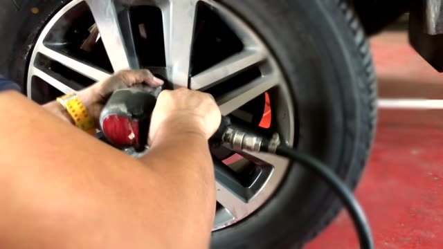 scene of tire removal at car service - accelerator pedal stock videos & royalty-free footage