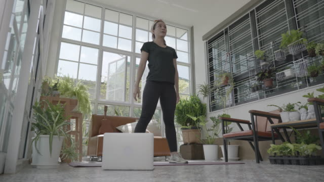 scene of young asian woman practicing exercise at home by following an online tutorial , concept social teleconferencing - yoga stock videos & royalty-free footage