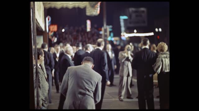 vídeos de stock e filmes b-roll de scene outside the rko pantages theater, as attendees arrive and enter the theater. - pantages theater