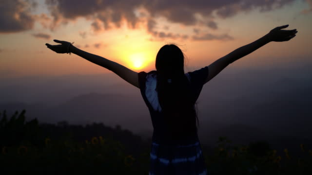 scene silhouette woman freedom over the mountain at sunrise. feeling nature - mountain climbing stock videos & royalty-free footage