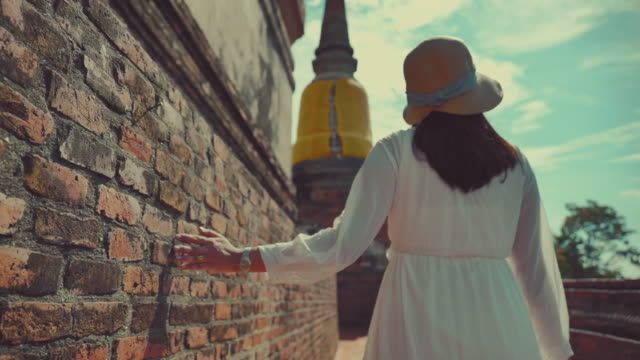 scene slow motion of asian woman enjoy travel old city in temple at ayutthaya, asian woman solo travel at temple is famous place old city at ayutthaya - spirituality stock videos & royalty-free footage