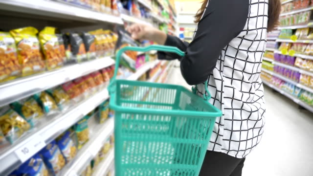 scene slow motion of asian young woman shopping in supermarket, concept of lifestyle in city - market research stock videos and b-roll footage