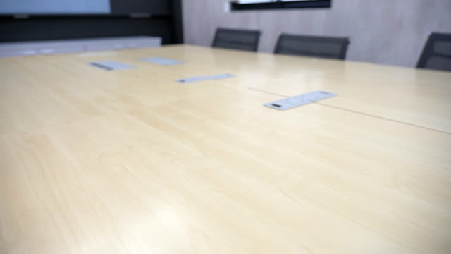 scene slow motion of empty conference room with table and chairs, close up of empty business modern offices, nobody working in office - part of a series stock videos & royalty-free footage