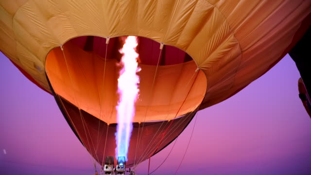 scene slow motion of hot air balloon, fire bursts in the balloon - rigging nautical stock videos & royalty-free footage