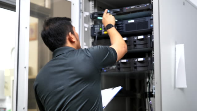 scene slow motion of it technicians checking equipment in the server room, concept of technology - it support stock videos & royalty-free footage