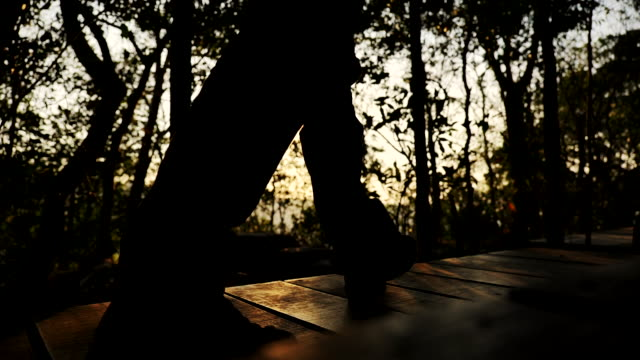 scene slow motion of man hiking on a forest trail, lifestyle people - outdoor pursuit stock videos & royalty-free footage