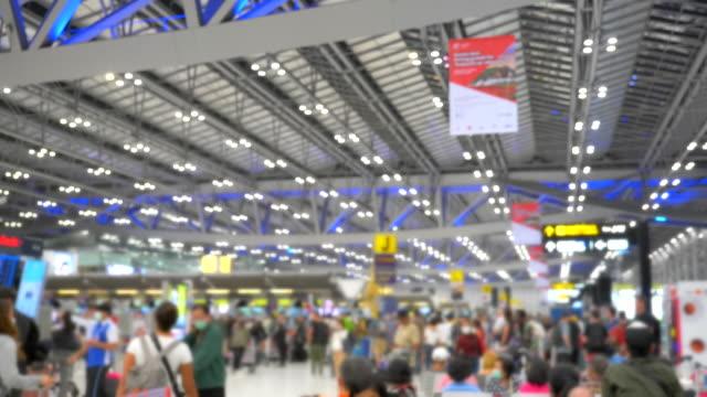 scene slow motion of passengers walking in suvarnabhumi airport, bangkok - gate stock videos & royalty-free footage