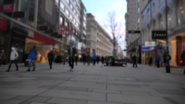scene slow motion of people walking karntner strasse street at vienna in austria - vienna austria stock videos & royalty-free footage