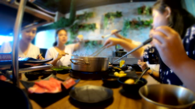 Scene time lapse of a group of teens asian is eating shabu-shabu at shopping mall in Taiwan, Concept of lifestyle people in city