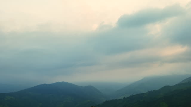 scene time lapse of the cloud stream above beautiful mountains - dusk stock videos & royalty-free footage