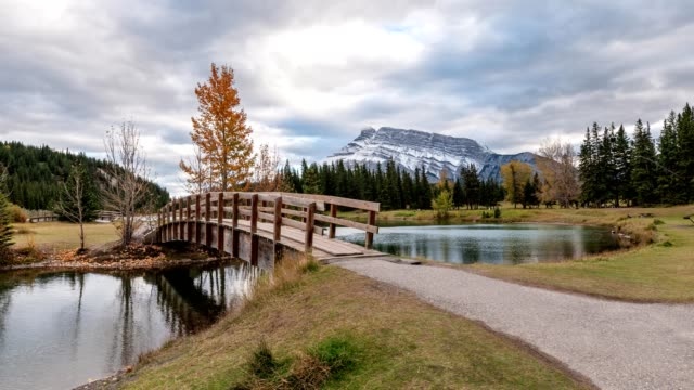 scenery of cascade ponds with mount rundle in autumn park at banff national park - banff national park stock videos & royalty-free footage