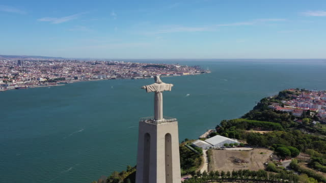 scenery of cristo rei (statue of christ) and downtown district / lisbon, portugal - protestantism stock videos & royalty-free footage
