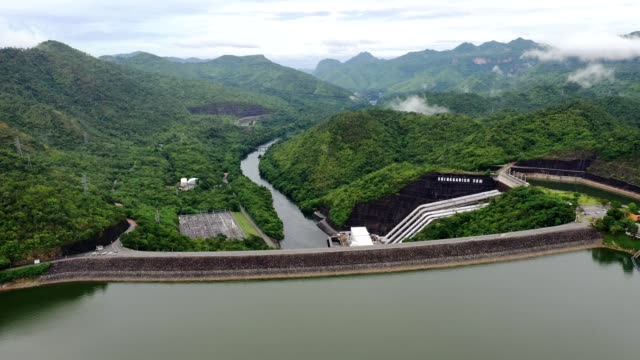 scenery of dam in tropical rainforest with hydro power plant in national park - hydroelectric power stock videos & royalty-free footage