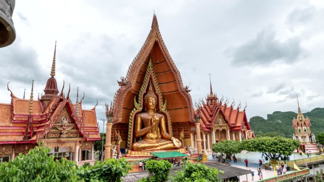 scenery of golden pagoda with big buddha on hill at wat tham sua - temple building stock videos & royalty-free footage