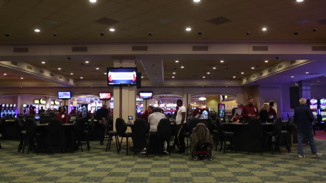 vídeos y material grabado en eventos de stock de scenes around gambling floor and sports book area after the launch of fullscale sports betting at dover downs casino in dover delaware us on tuesday... - apuestas deportivas