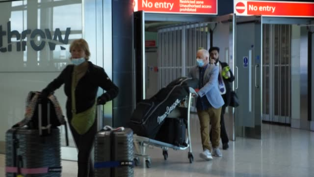 scenes at heathrow airport in london after britain introduced a two-week quarantine for most people arriving from abroad to try to limit the spread... - sparks stock videos & royalty-free footage