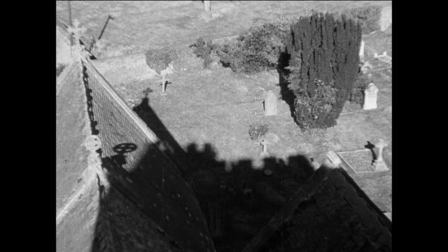 vidéos et rushes de montage scenes from a quiet british village including a church, cemetery, homes, and cottages / england, united kingdom - cimetière