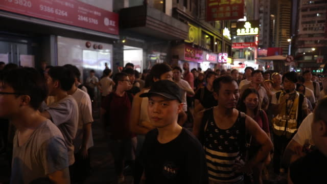 stockvideo's en b-roll-footage met scenes from city streets and victoria park during hong kong protests at causeway bay in nighttime and daytime hong kong china on sunday aug 11 2019 - placard