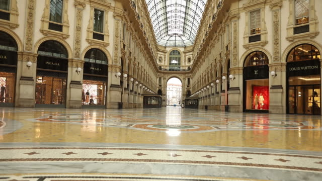 scenes from first day in city after massive shut down during coronavirus epidemic milan lombardy italy on thhursday march 12 2020 - office block exterior stock videos & royalty-free footage