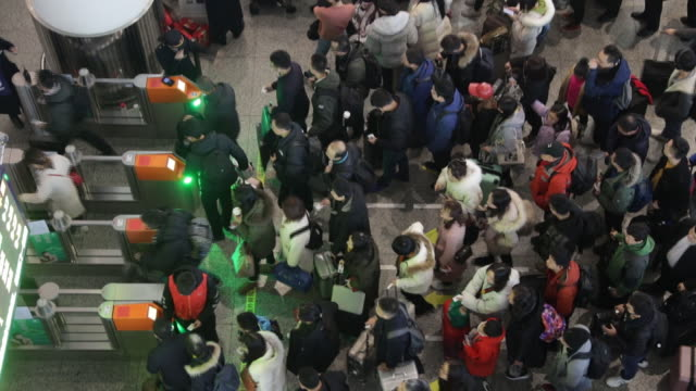 scenes from hongqiao railway station crowded by passengers shanghai china on saturday january 18 2020 - ticket counter stock videos & royalty-free footage