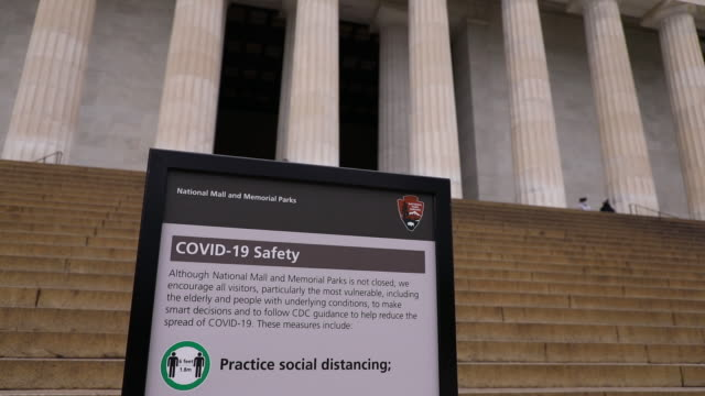 scenes from nearly empty city with partially closed national mall area. mayor muriel bowser announced stay-at-home orders on monday allowing people... - information sign stock videos & royalty-free footage