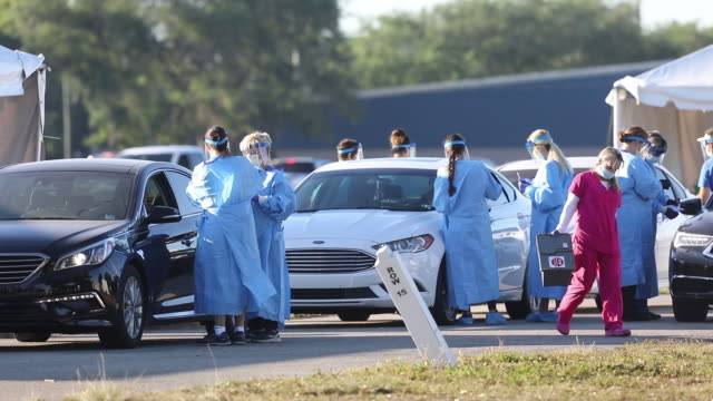scenes from parking lot of raymond james stadium where healthcare workers doing tests for covid19 this is the second week that the drivethrough... - test drive stock videos & royalty-free footage