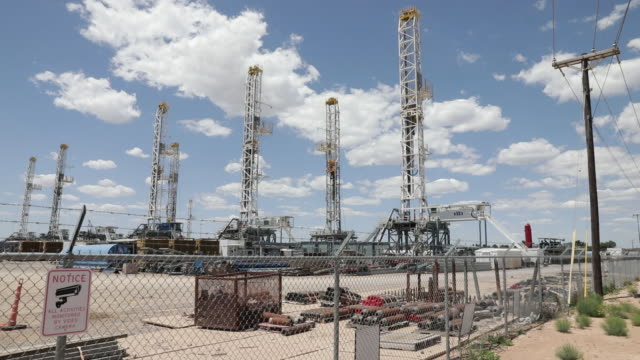 scenes from permian basin oil field areas. pandemic caused economic slowdown. the price for the u.s. benchmark for crude oil, west texas... - industrial district stock videos & royalty-free footage