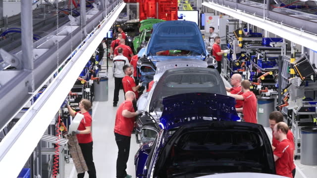 scenes from porsche ag factory outdoors and indoors where new porsche taycan is produced stuttgart badenwürttemberg germany on thursday march 5 2020 - autofabrik stock-videos und b-roll-filmmaterial