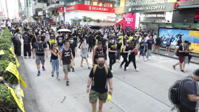 scenes from protests in mong kok district at daytime and nighttime hong kong china on monday aug 5 2019 - mong kok stock videos and b-roll footage