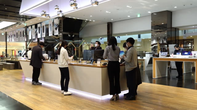 scenes from samsung d'light flagship store during coronavirus epidemic. chinese factories hit by disease look to restart production, the pain is only... - hygiene stock videos & royalty-free footage